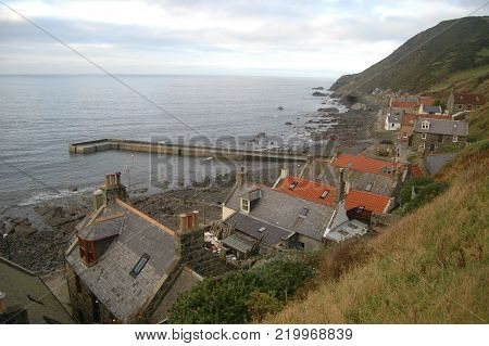 The Rooftops and Harbour of Remote Coastal Village of Crovie, Scotland