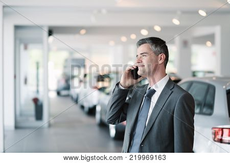 Businessman At The Car Showroom