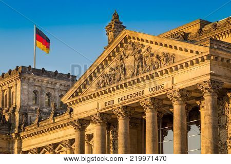 Close-up view of famous Reichstag building, seat of the German Parliament (Deutscher Bundestag), in beautiful golden evening light at sunset, Berlin, Germany