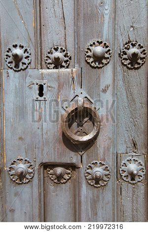Detail Of Knocker And Lock Of Ancient Wooden Door