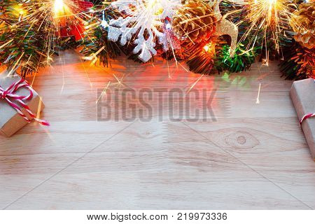 Christmas background with copy space for product montage or text message. xmas tree on wood table.
