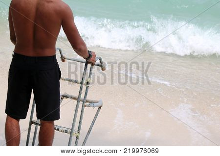 Asian strongest man, Lifeguards with ladders for long-tail boat on the beach