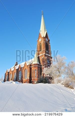 Mikkeli, Finland. Lutheran Cathedral before early winter sunset