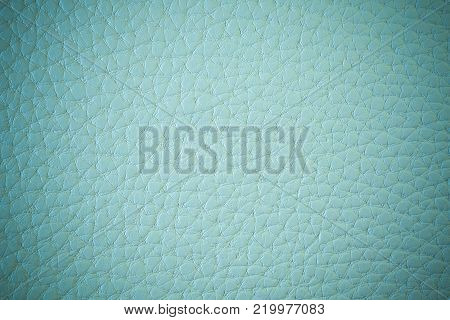 Texture of artificial leather. Greenish blue background or leatherette backdrop.