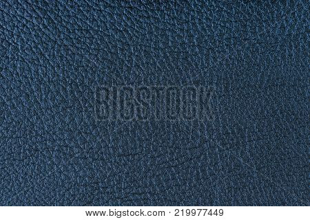 Texture of artificial leather. Blue background or leatherette backdrop.