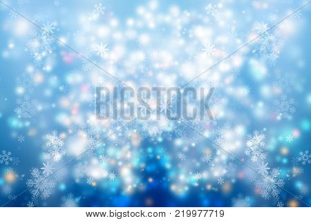 White Snowflakes on blue blur abstract background. Bokeh Christmas blurred beautiful shiny Christmas lights. Snow background. Snowflakes overlay on winter background.