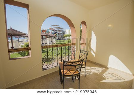 View from a balcony terrace of luxury hotel resort room with swimming pool aqua park and gardens