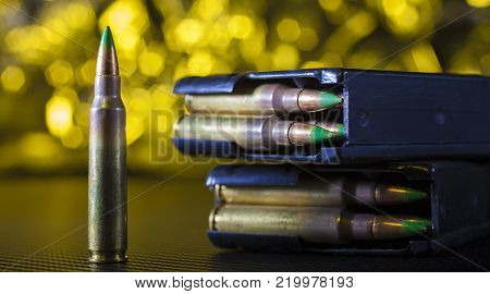 Ammunition and magazines for an AR-15 with a yellow background
