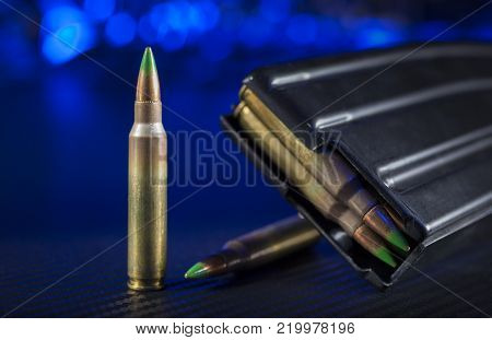 Cartridges and a magazine for an AR-15 with a blue background
