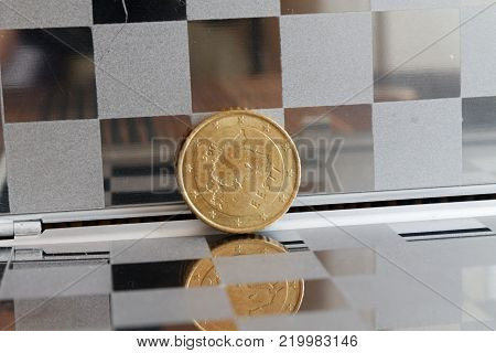 Euro coins in mirror reflect lies in chequered wallet, background Denomination is 50 euro cents - back side