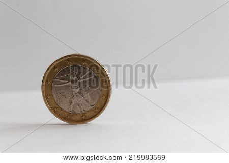 One euro coin on isolated white background Denomination is 1 euro - back side