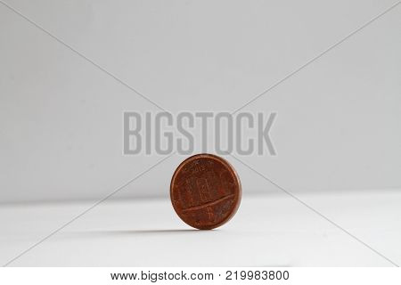 One euro coin on isolated white background Denomination is 1 euro cent - back side