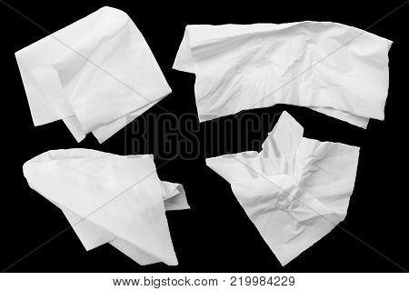 White tissues on black background. clipping path. Four napkin paper.