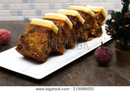 A sliced tray bake traditional British Christmas = fruit cake with