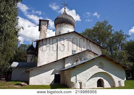 The Church of St. Nicholas of Usokha in Pskov. A typical architecture of an Orthodox Church from the 16th century on the North-West of Russia. The whitewashed building with a wooden dome.