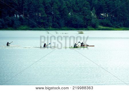 Women compete in rowing on kayaks. The competitions among women on the lake