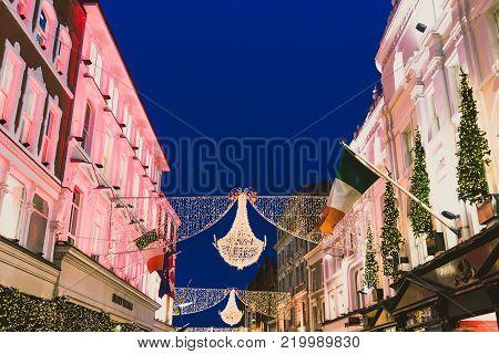 DUBLIN, IRELAND - December 24th, 2017: Christmas lights adorning the famous shopping area of Grafton Street's city center