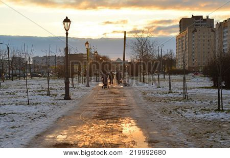 Alley at winter evening in microdistrict Rybatskoe on the outskirts of St. Petersburg, Russia.