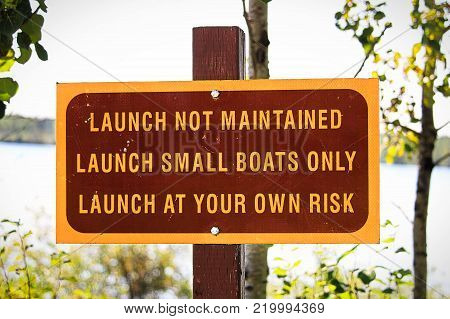 A launch not maintained use at own risk sign.