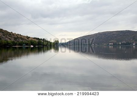 Lake Orestiada is one of the most beautiful lakes in the Balkans on a dull autumn morning.