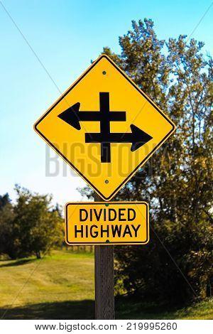 Closeup of a divided highway warning sign.