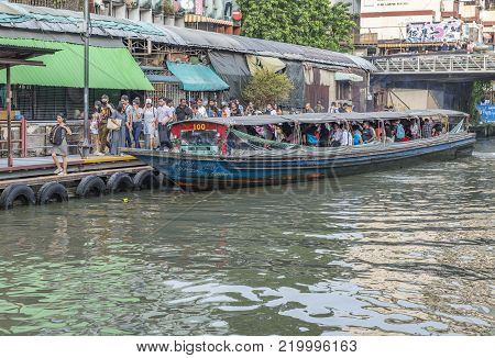 Bangkok, Thailand - Dec 2, 2017 Passengers get off the express boat at station.