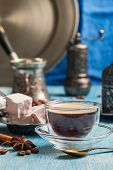 Turkish coffee and turkish delight with traditional embossed metal tray and cup poster
