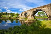 Old bridge with arches, turrets and buttresses crosses the Forth in Stirling, Scotland, scene of the historic Battle of Stirling Bridge where Scots led by William Wallace defeated the English in 1297. poster