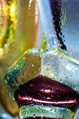 Bright colorful abstract background. Glass and drops of water. Closeup. poster