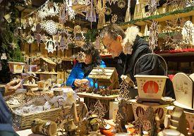Cologne, Germany - December 16, 2017: Handmade crafts vendor at the Christmas Market. A vendor sells handmade wood crafts at the annual Cologne Cathedral Christmas market.