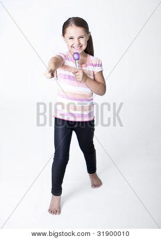 Cute little Pop Star singing on white background