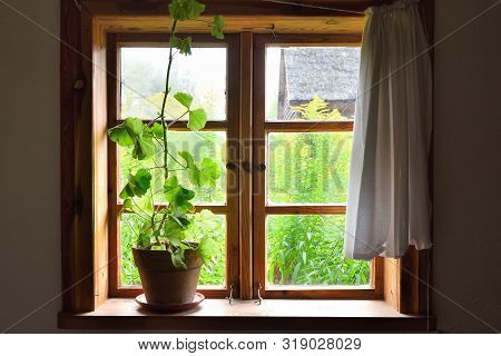 Window Of Old Wooden Farmstead In Open-air Museum, Polish Folk Culture. Poland, Europe
