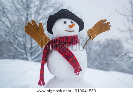 Christmas Snowman On White Snow Background. Greeting Snowman. Snowman With Light Star In Christmas D