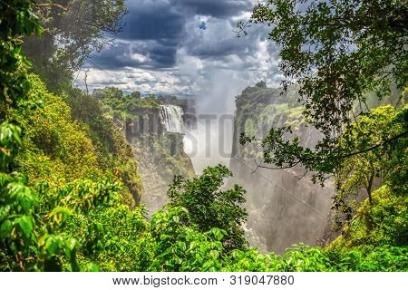 Victoria falls is a popular touristic destination in Africa at the border between Botswana, Zimbabwe and Zambia