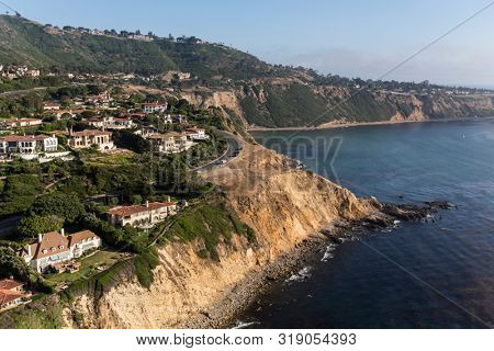 Coastal aerial view of ocean bluffs and homes in the Rancho Palos Verdes area of Los Angeles County, California.