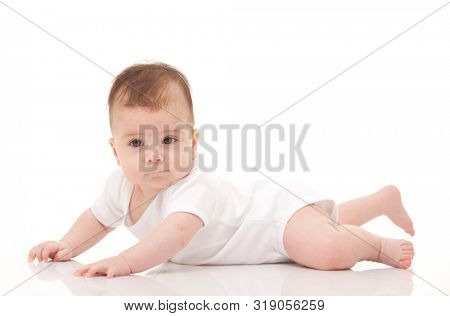 Cute baby isolated on white background. Happy childhood. Close up portrait of happy baby. Fun kid in white pajama on white