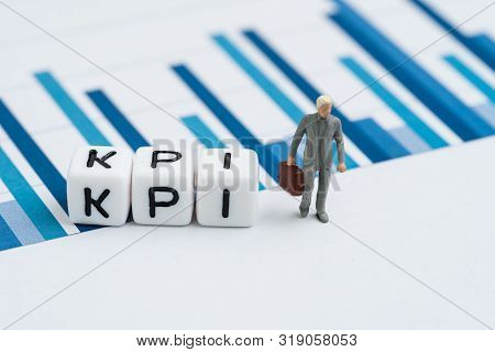 Kpi, Key Performance Indicator For Company Goal Concept, Small Cube Block With Alphabets Building Th