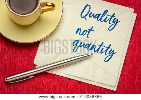 quality not quantity - inspirational handwriting on a napkin with a cup of coffee