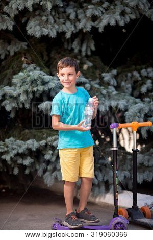 boy with a bottle of water in his hands