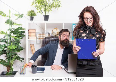 Charming Nerd. Sexy Female Employee With Nerd Look Standing In Front Of Employer. Adorable Nerd Girl