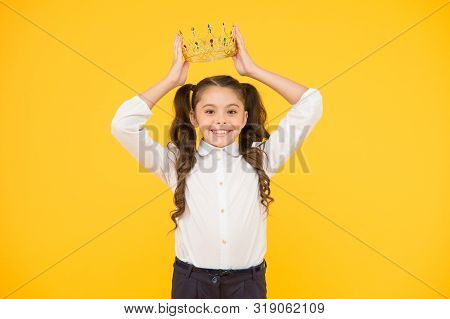 Winner Revealed Happy Little Prize Winner Putting Crown Jewel On Head On Yellow Background. Adorable