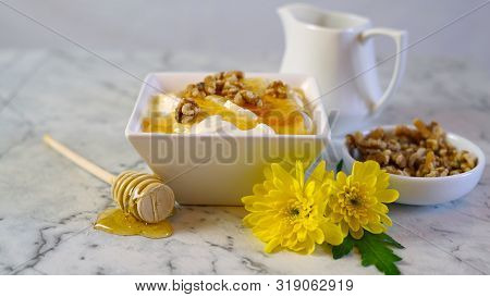 Greek Yoghurt Served With Natural Raw Honey And Walnuts