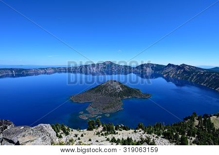 Crater Lake And Wizard Island In Crater Lake National Park , Oregon On A Clear Calm Summer Day.