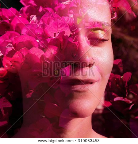 Double exposure portrait combining beautiful flowers and branches with a woman's face