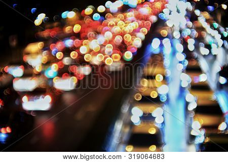heavy traffic congestion in the city. car headlights and rear lights defocused. road light bokeh. view from the top , high angle perspective. metropolis problem bad quality of life. poster