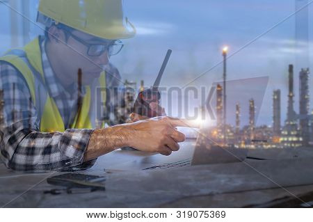 Petrochemical engineering man sitting in oil refinery building structure petrochemical industry. poster