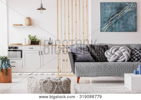 Abstract Blue Painting On Empty White Wall Of Open Plan Apartment