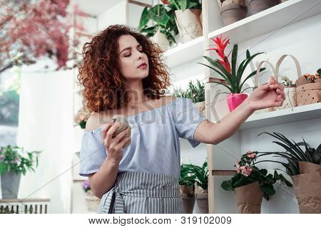 Curly Beautiful Girl Being Concentrated On Hunk Of Twine