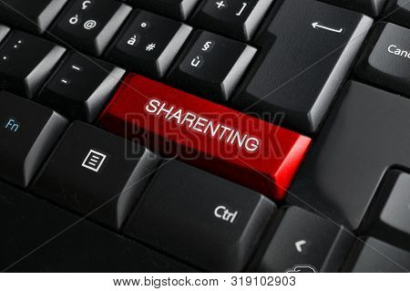 Sharenting (overuse Of Social Media By Parents To Share Content About Their Children) Concept: Black