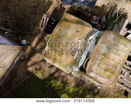 Bird Eye View Of A Rusty Abandoned Truck In The Scrap Yard